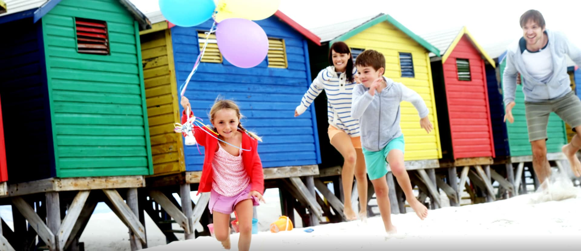Family running in sand San Leandro Smiles in San Leandro, CA